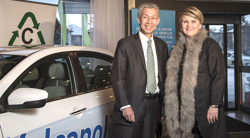 KC Tran, CEO and Co-Founder of CRI and Ragnheidur Elin Arnadottir Minister of Industry and Commerce of Iceland, with the Geely Emgrand EC7 methanol vehicle.