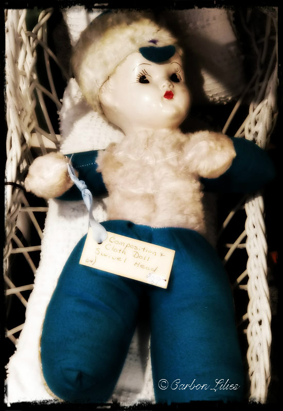 Though John hates dolls, this one kept calling her back & she had to take a photo.