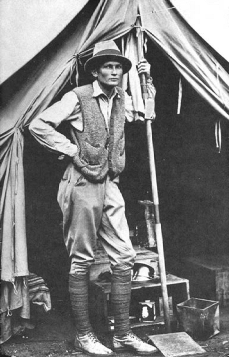 Hiram_Bingham_III_at_his_tent_door_near_Machu_Picchu_in_1912.jpg