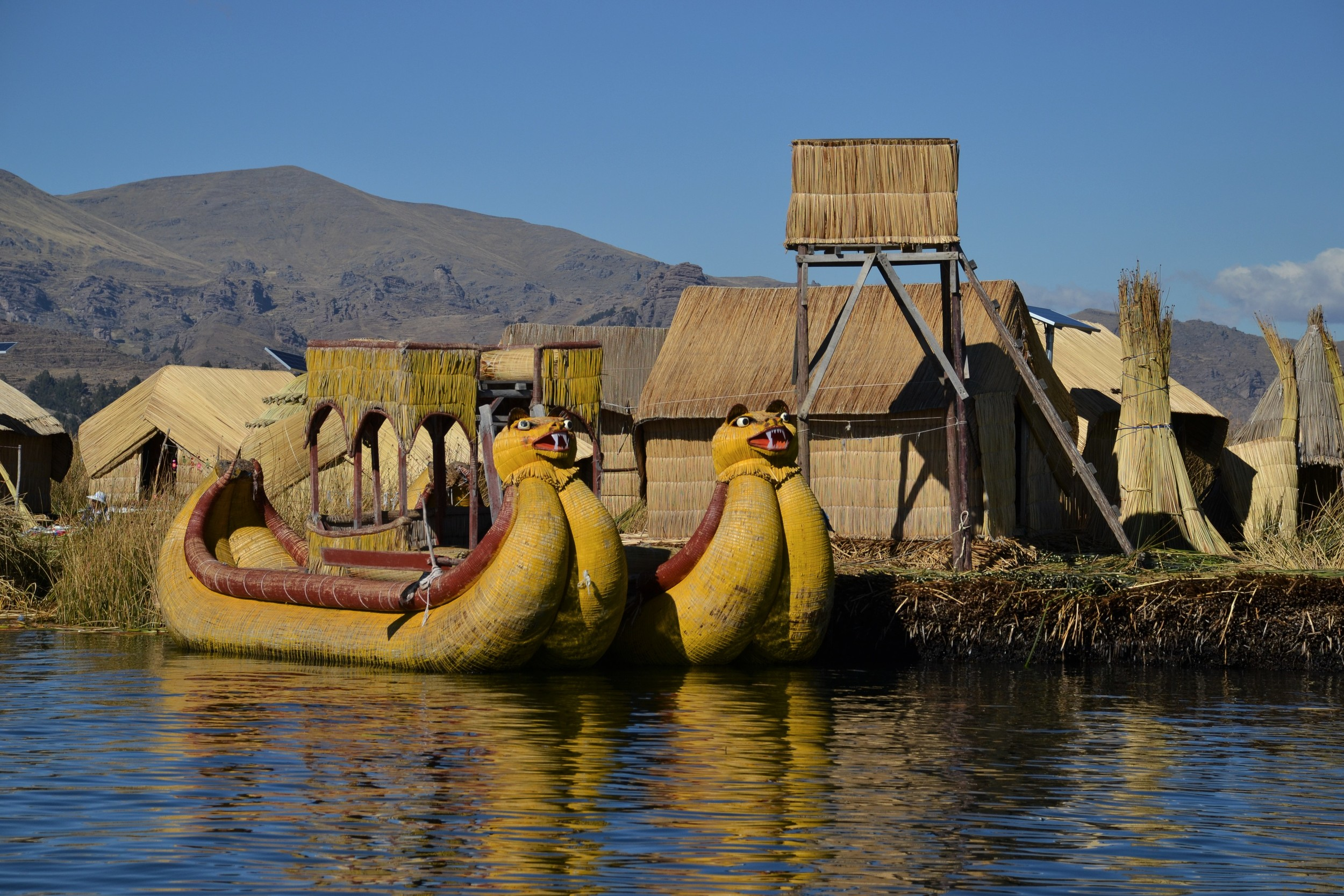 The Floating Islands of Lake Titicaca, and a traditional reed boat.