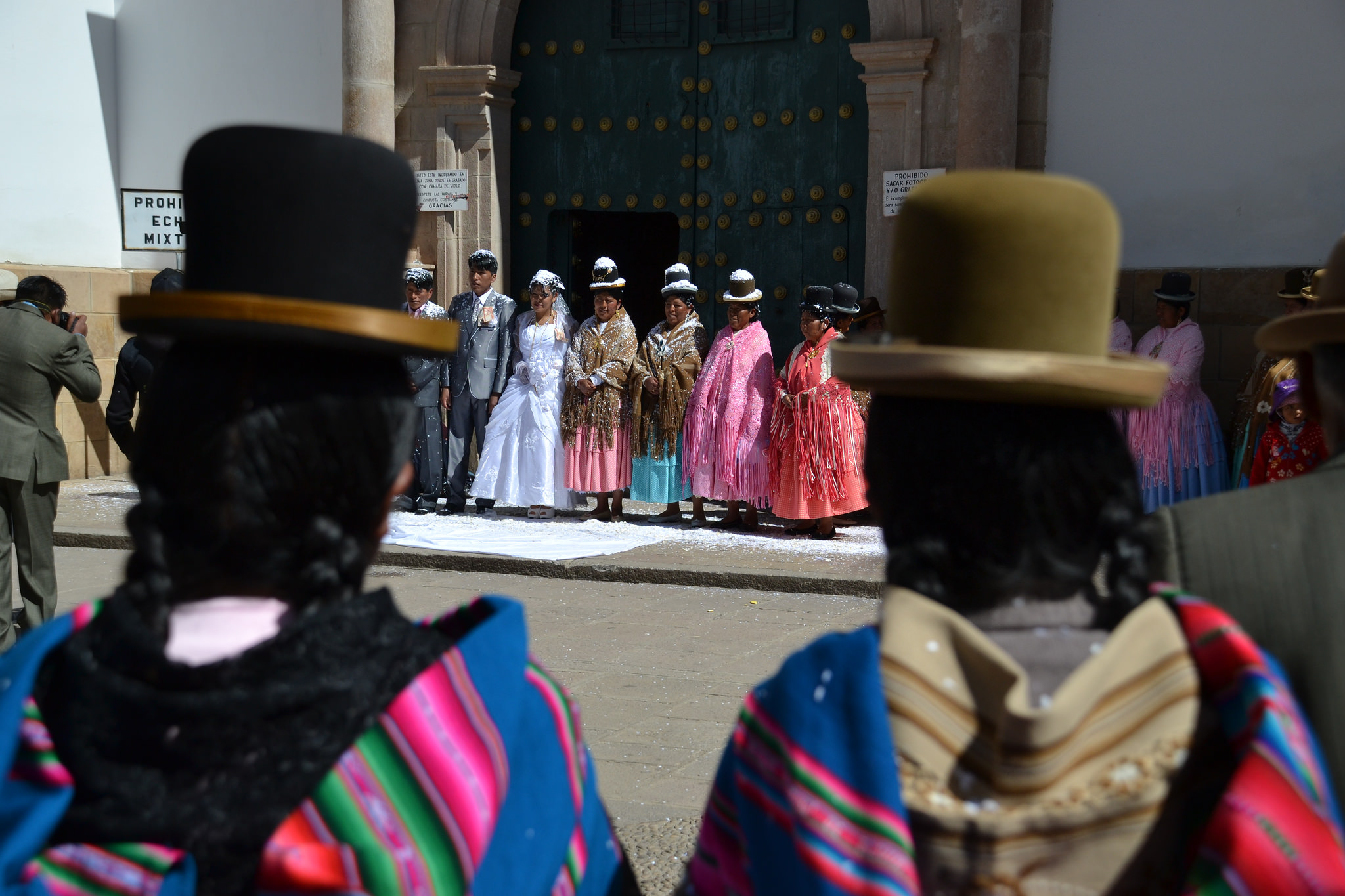 Bolivian women getting married in traditional dress.