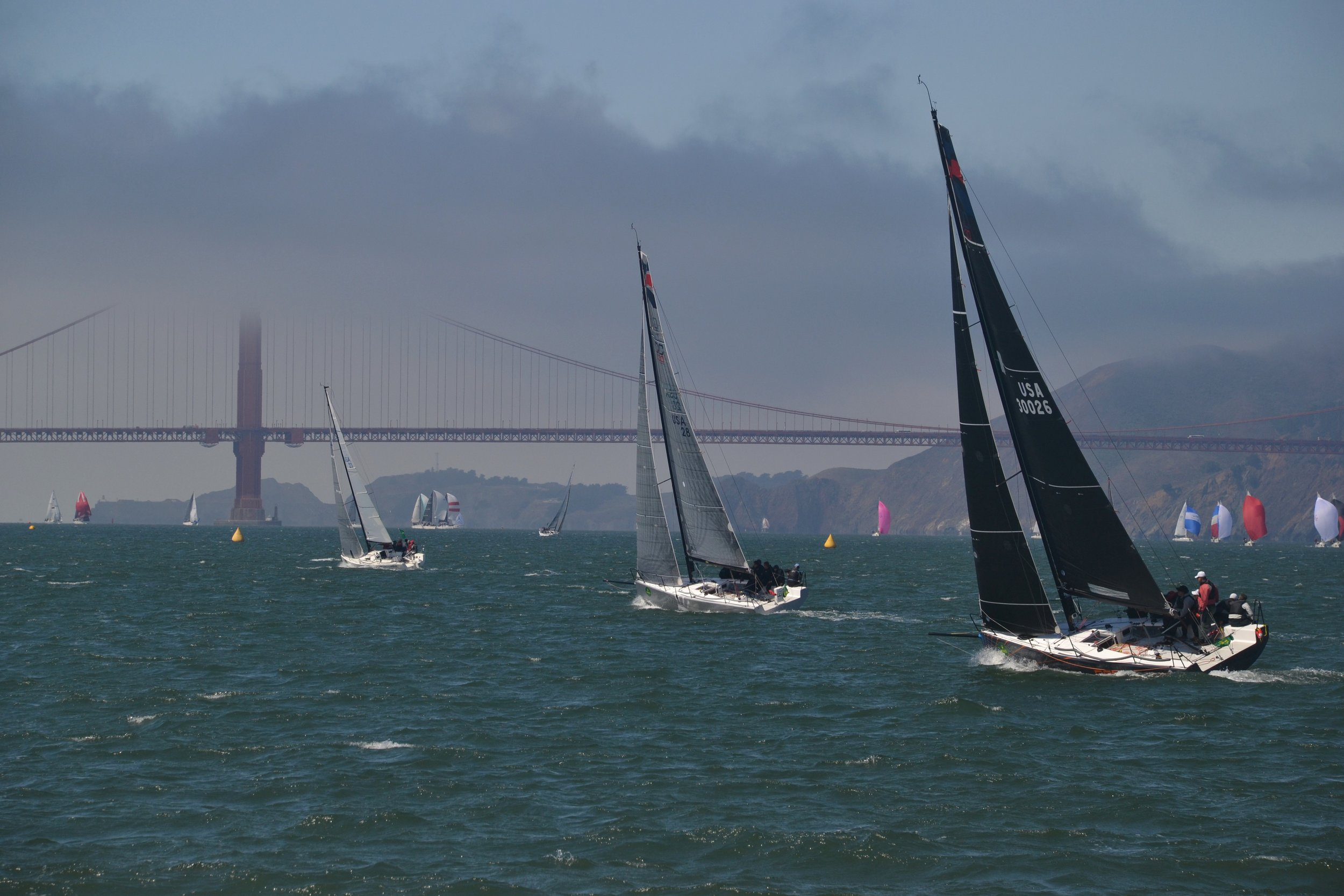 Boat racing beneath the Golden Gate bridge.