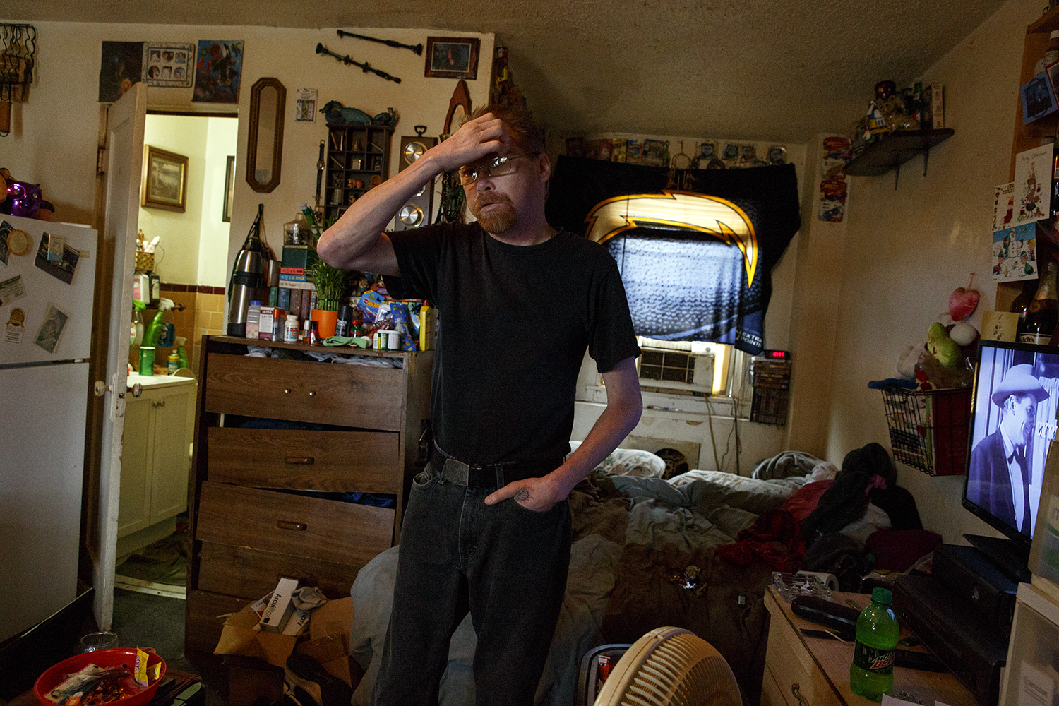 """Franklin Fite and his wife Karen Fliger have lived in a room at the Bel-Aire for nearly eight years. Everything they own is there with them.""""The only thing that belongs to the hotel is the bed,"""" Fite says."""
