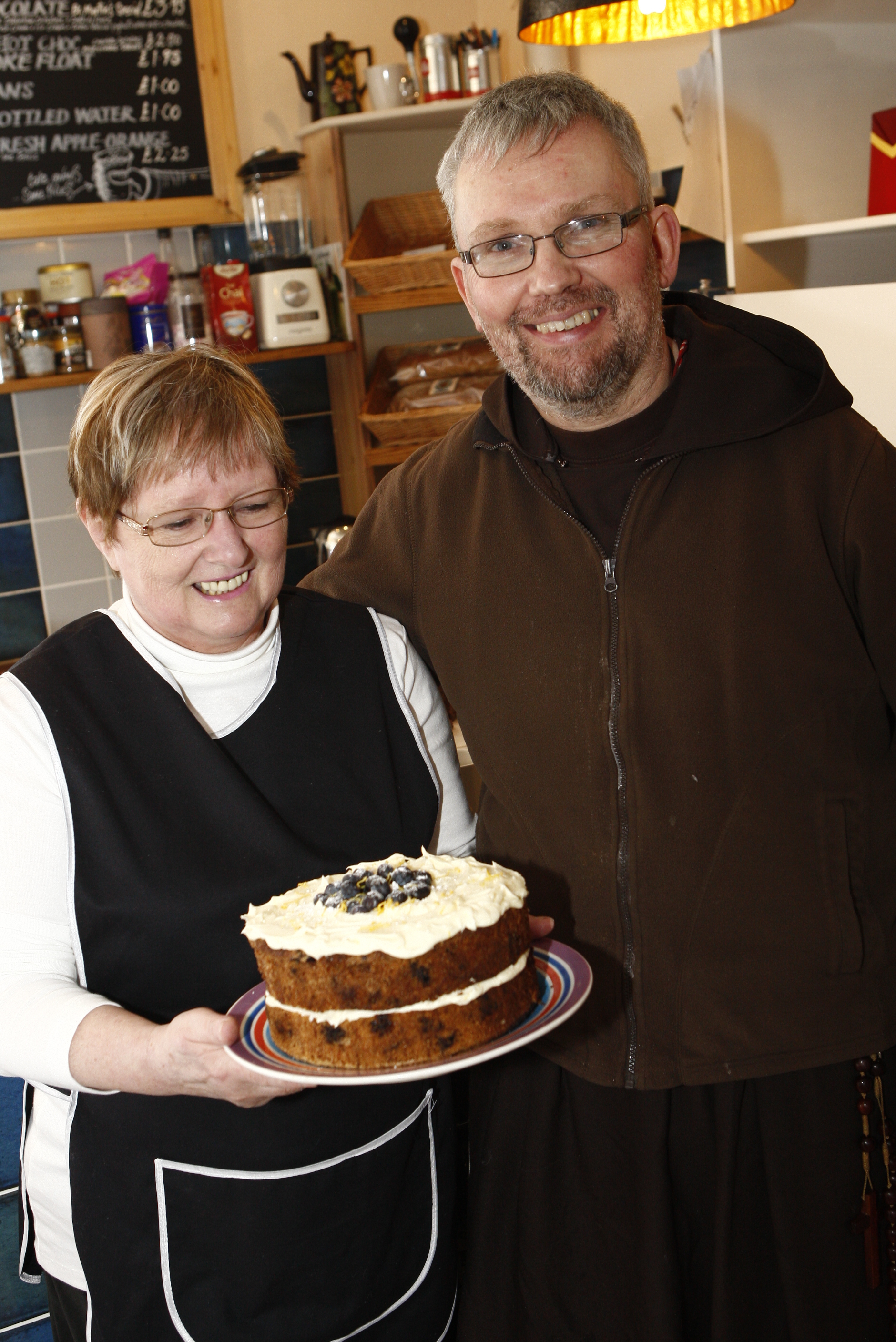 Father John Delaney dropping by for a piece ofJan's Blueberry and Zucchini sponge cake. Great cake Jan..