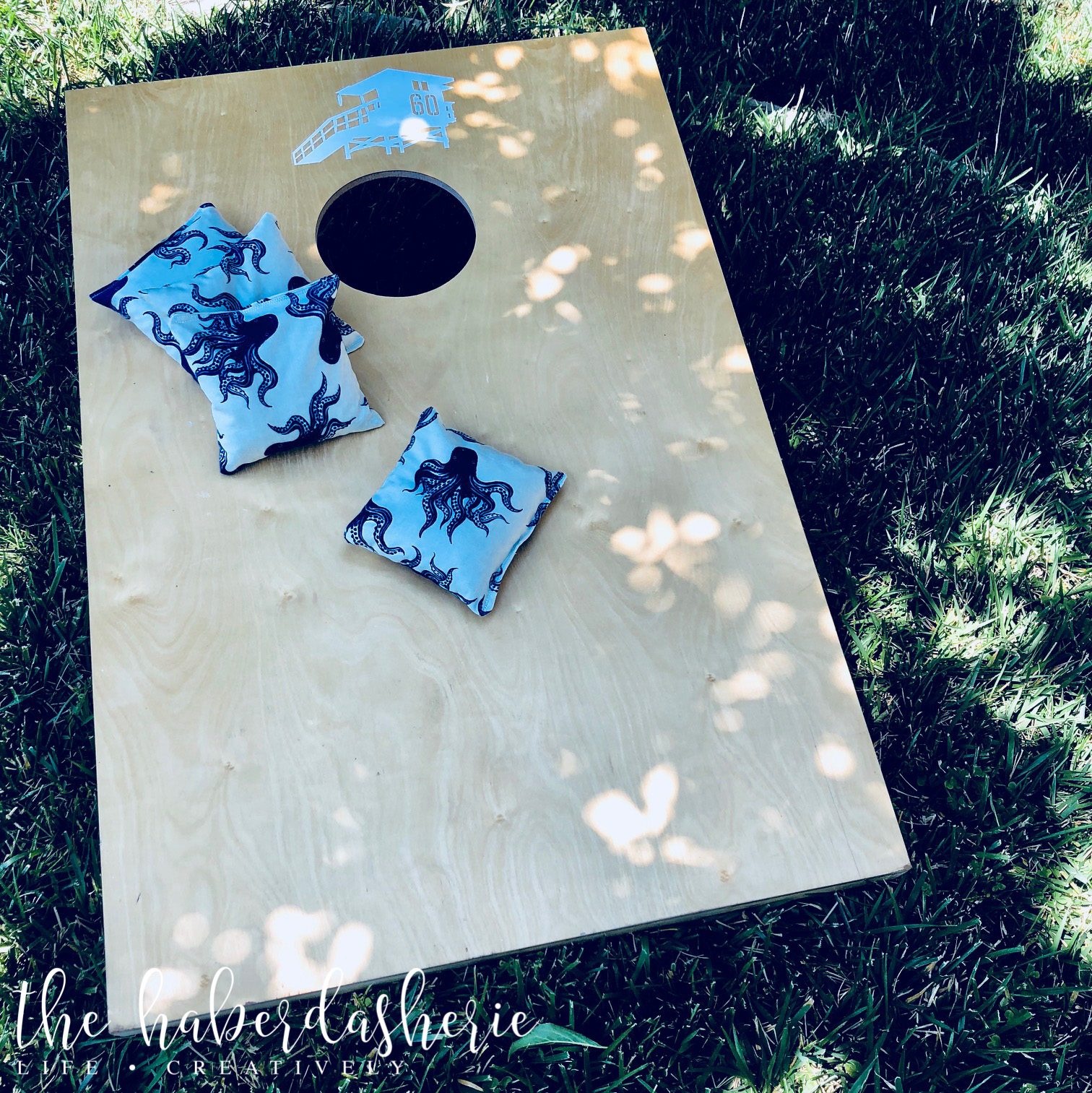 personalize your cornhole game with custom bean bags... + decals! { our beach house vibe includes decals provided by our local realtor,  Alex Abad Real Estate Group }