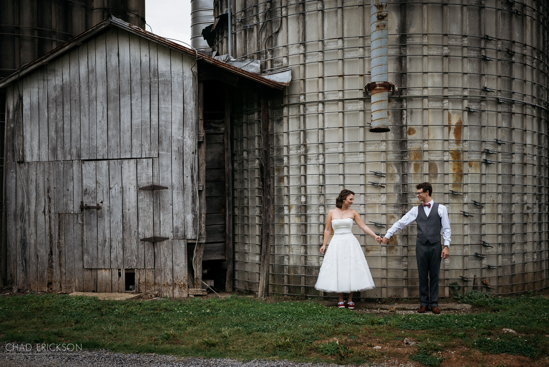 Bride and groom at barn at The Grove