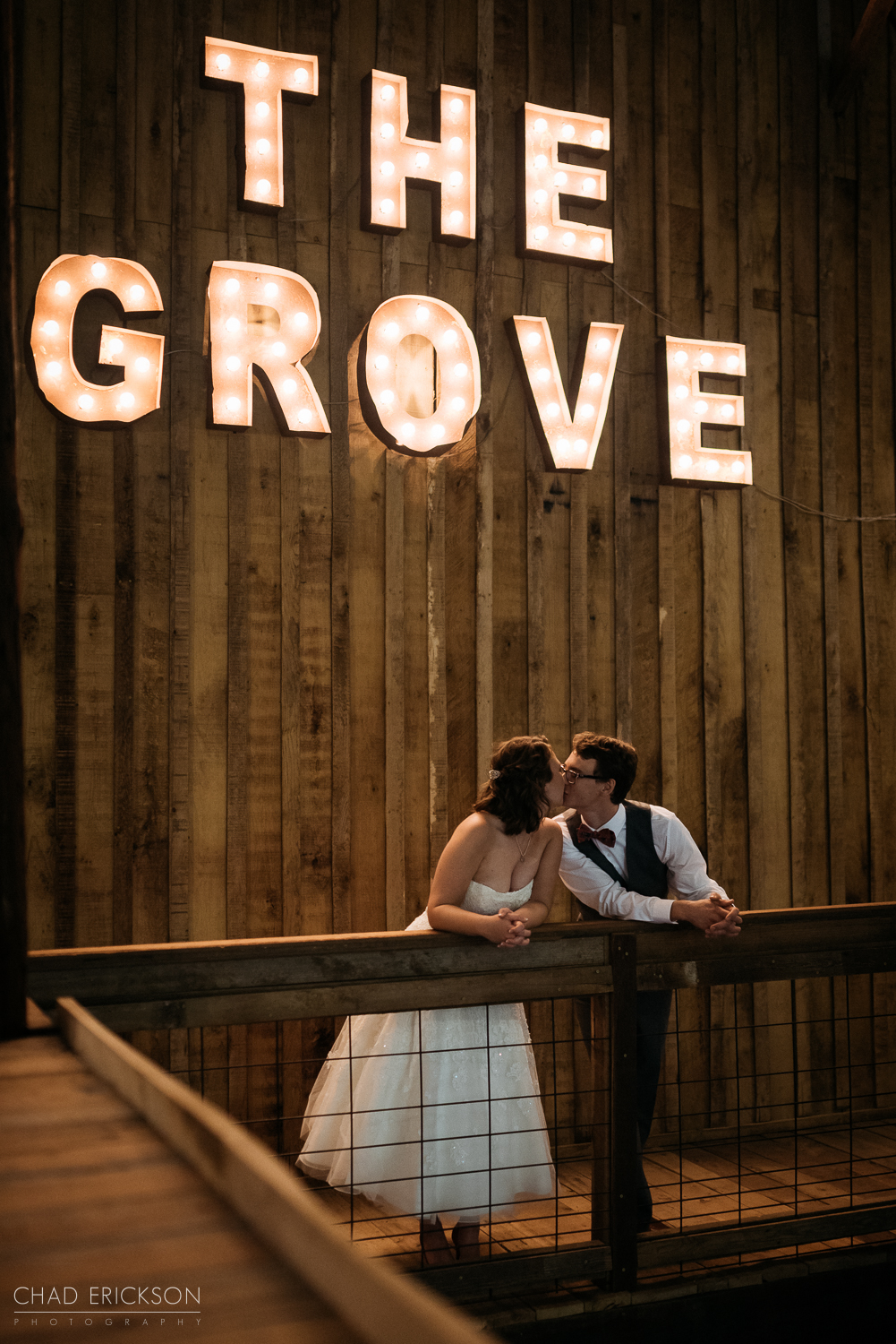 Bride and groom under The Grove sign