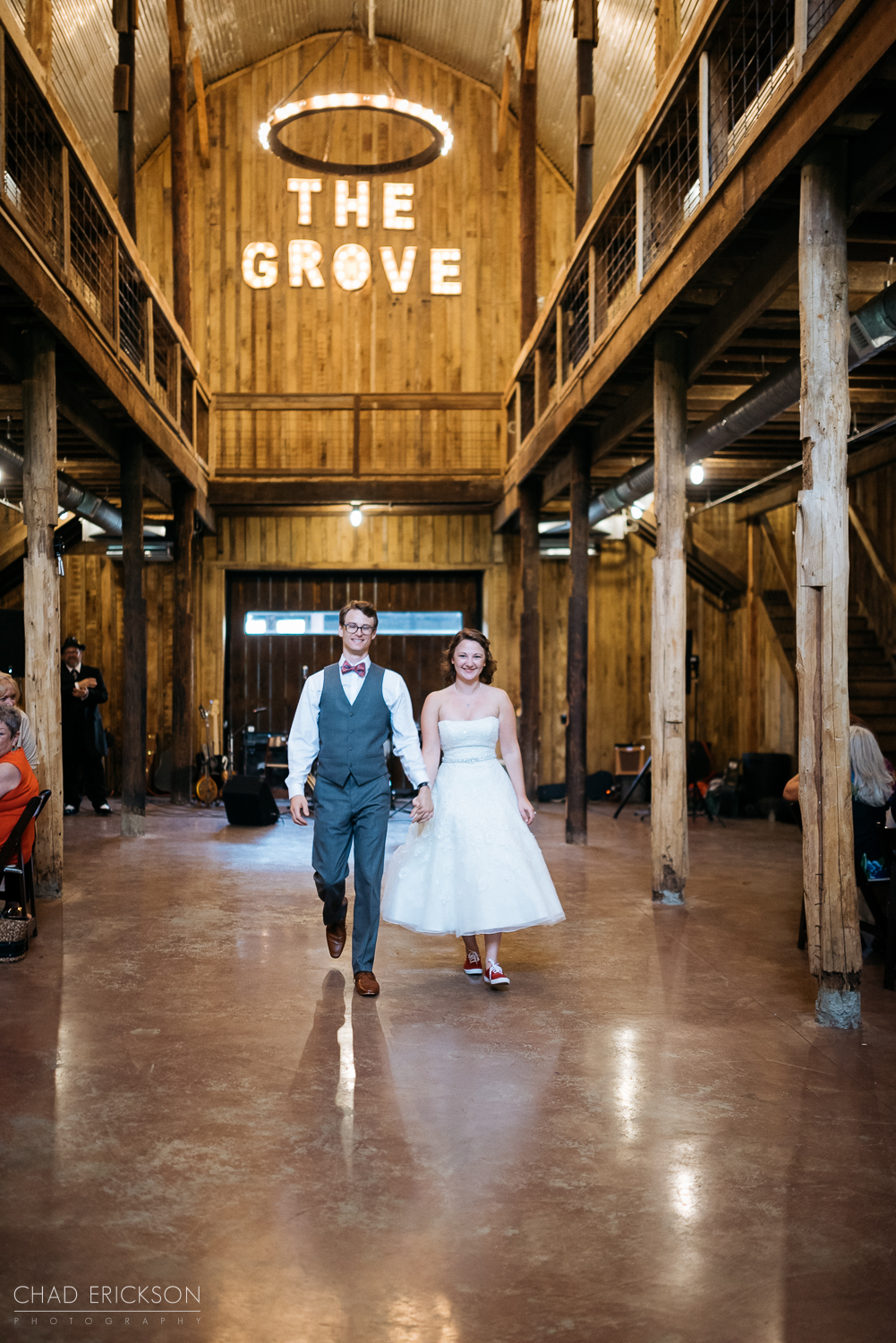 Bride and groom reception entrance under The Grove sign