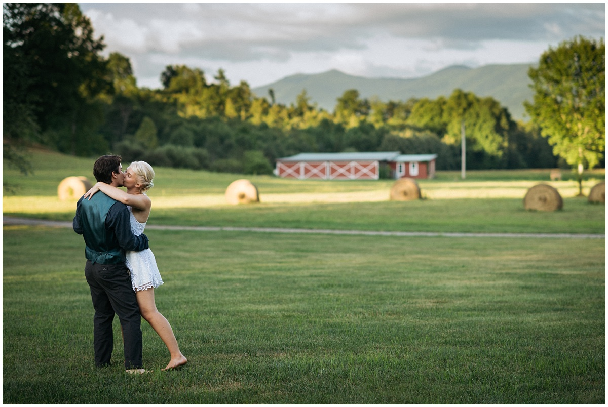 Couple dancing in front of McGuire's barn