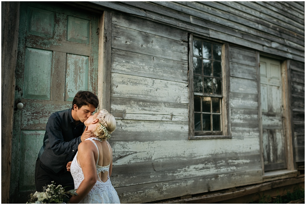 Bride & groom kissing at McGuires Farm house