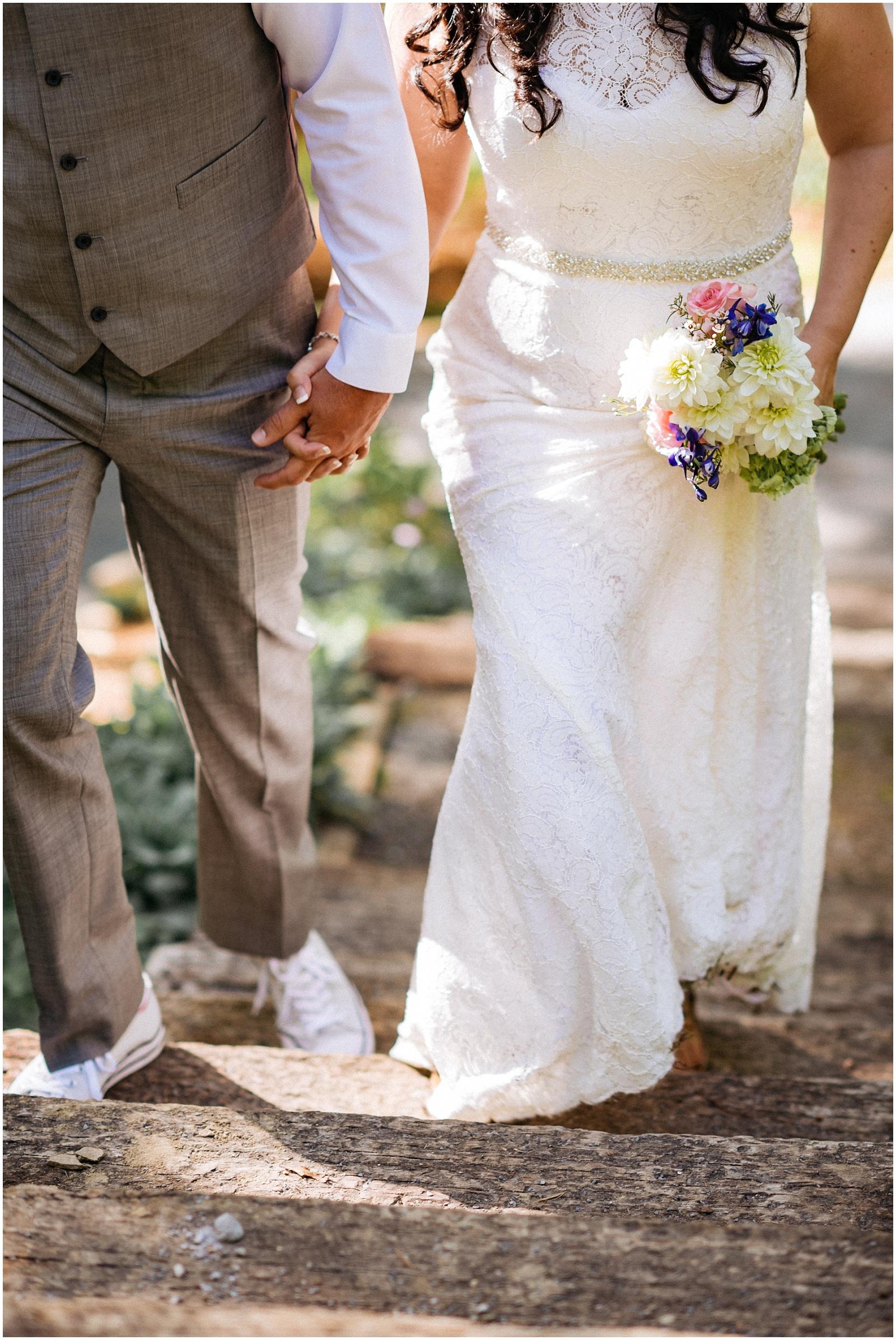 Couple holding hands at Nantahala W