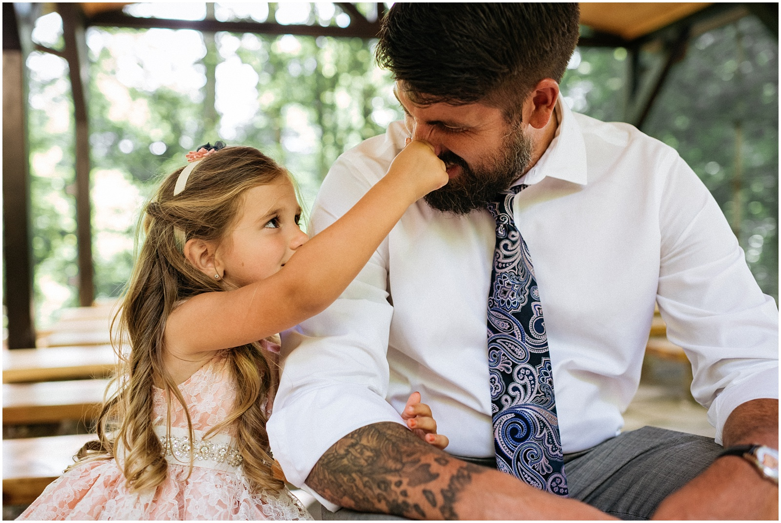 Daughter holding Dad's nose