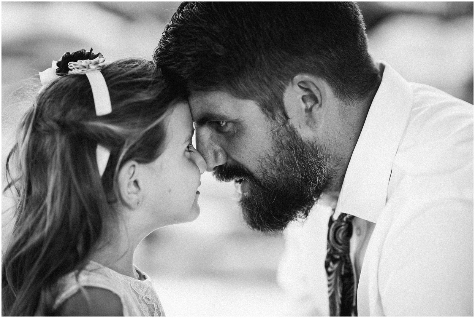 Father and daughter looking at each other