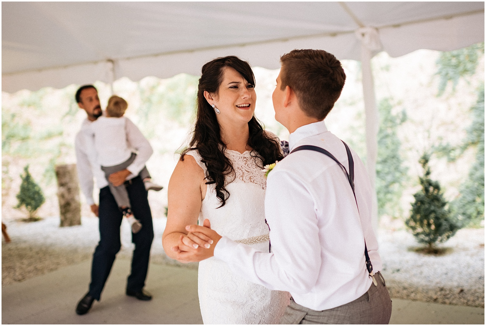 Bride laughing at son