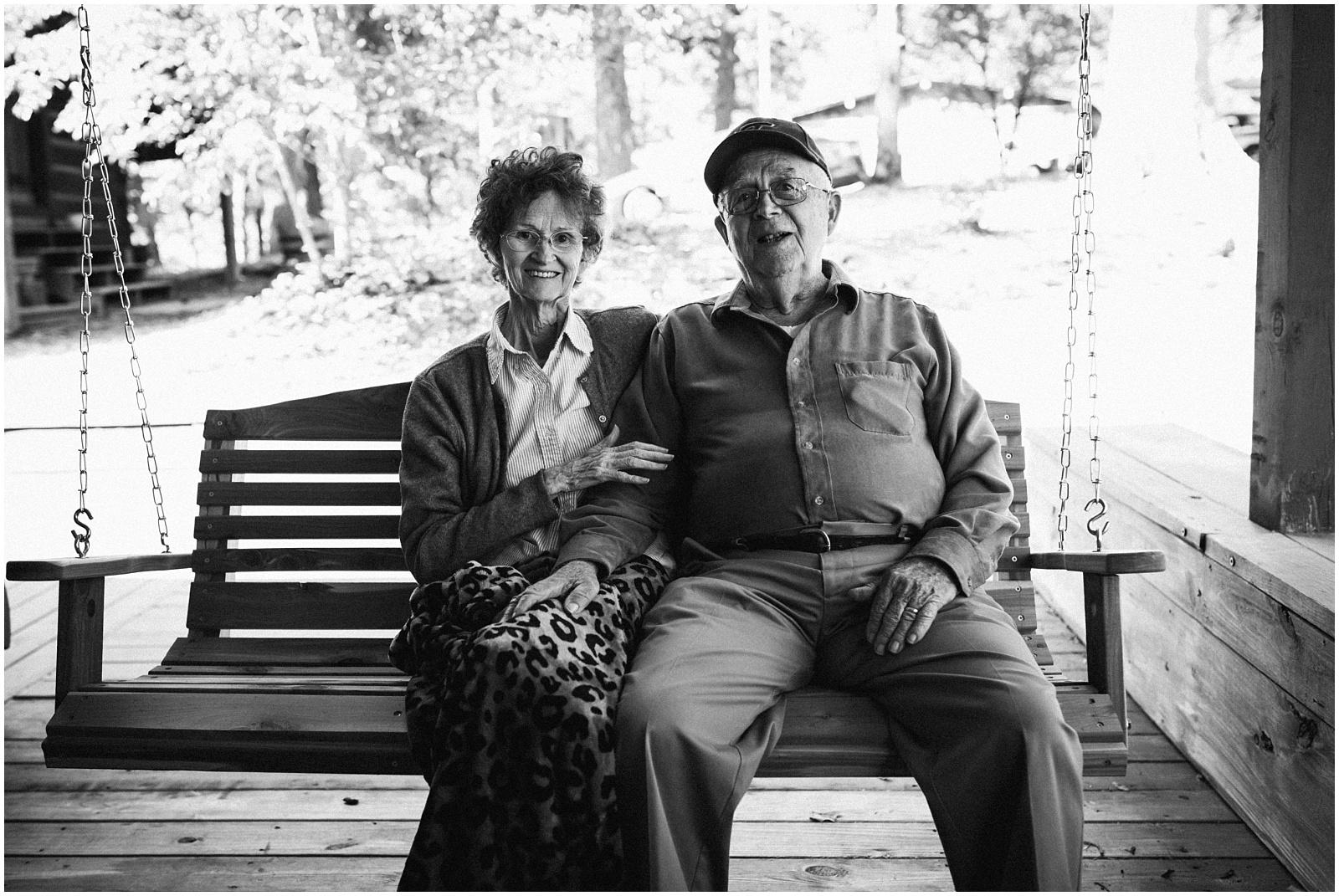 Grandma and granddad portrait on swing