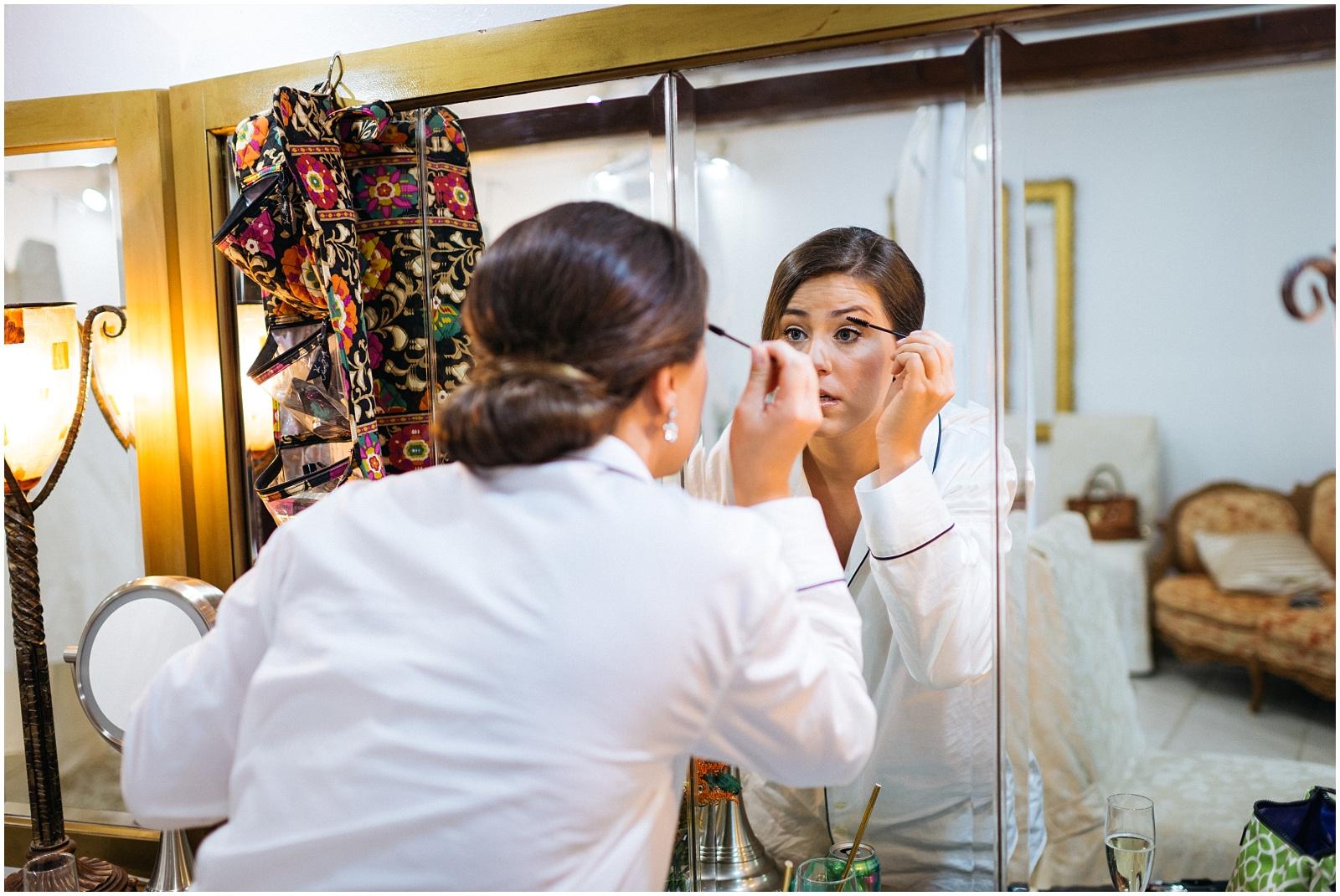 Candid Bride doing makeup