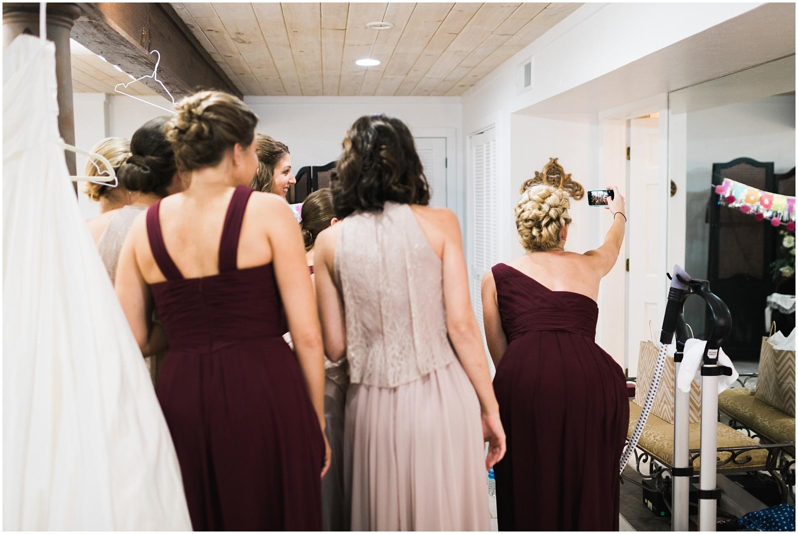 Bridesmaids taking selfie