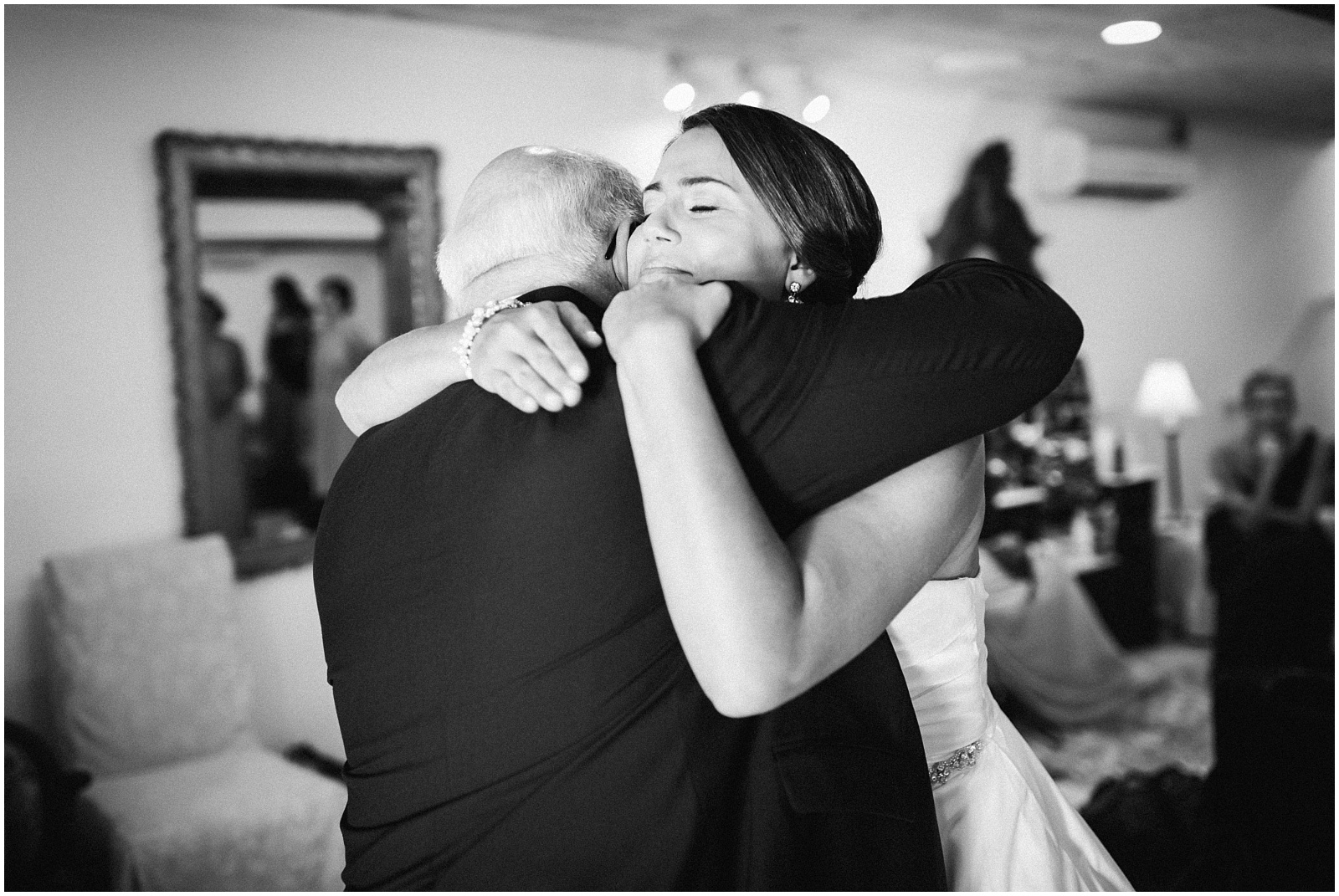 Candid father and daughter hug