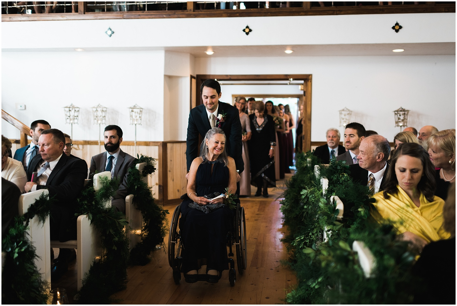 Groom and mother coming down aisle