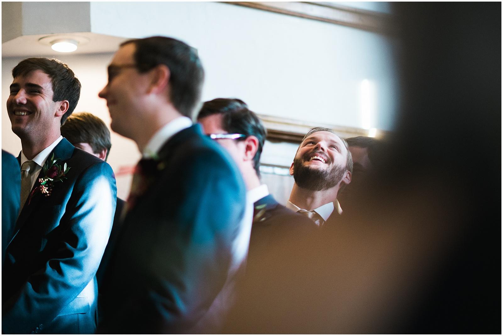 Groomsmen laughing candid