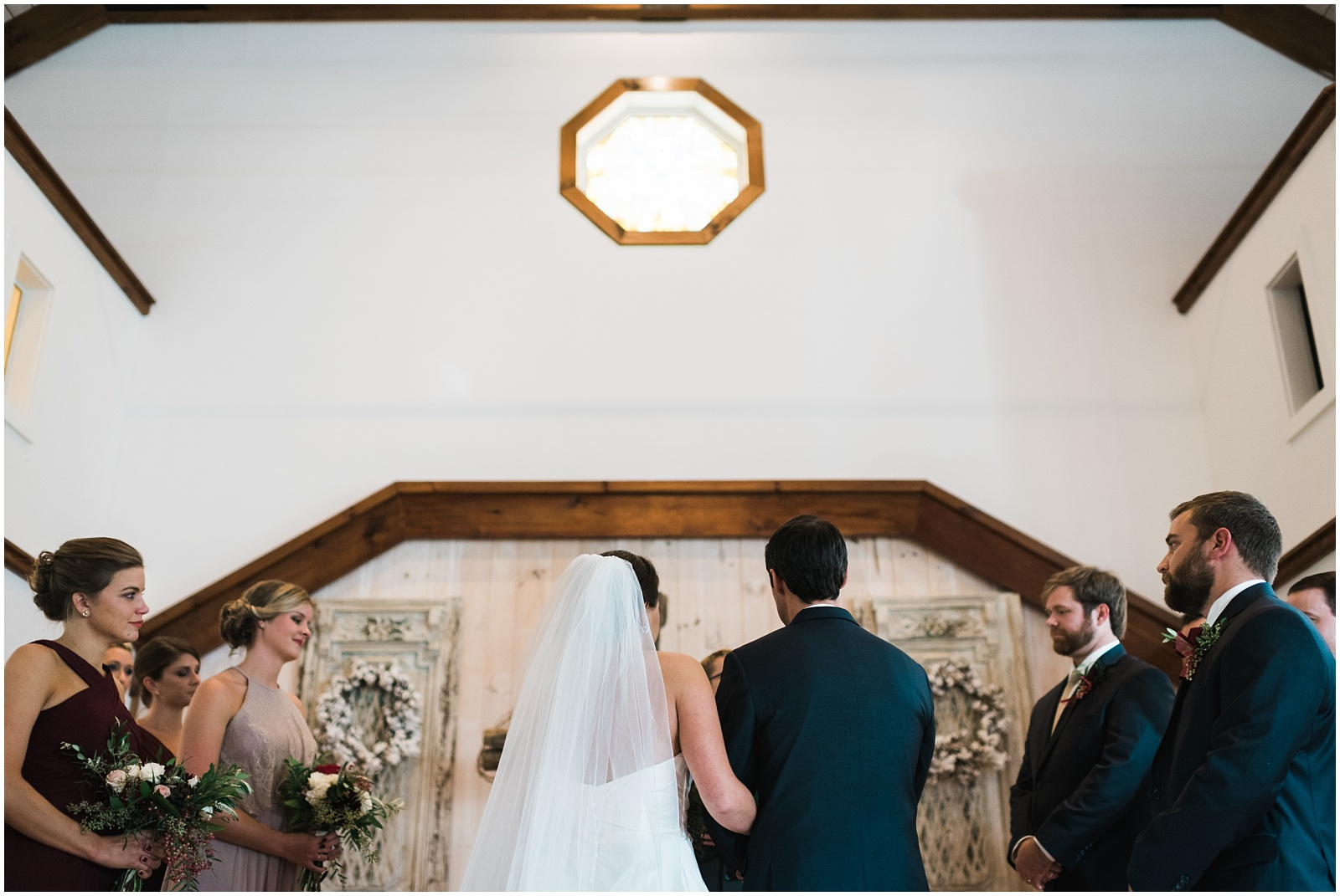 B&G at altar during ceremony