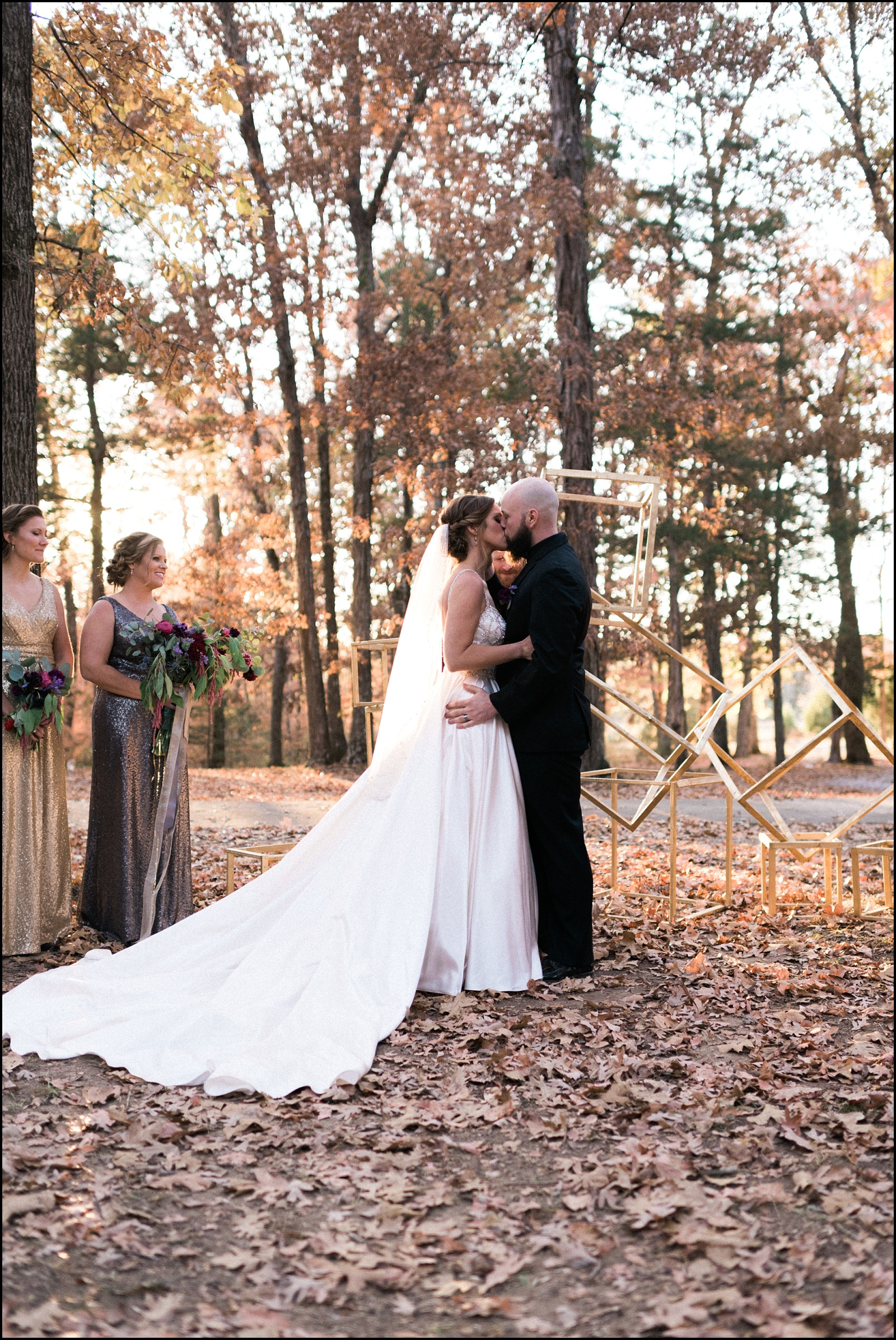 Fist kiss at ceremony at outdoor fall wedding in Nashville