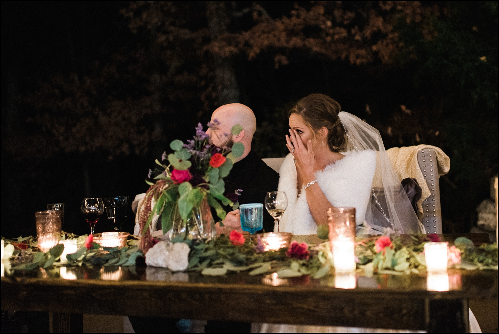 Bride crying at toast candid