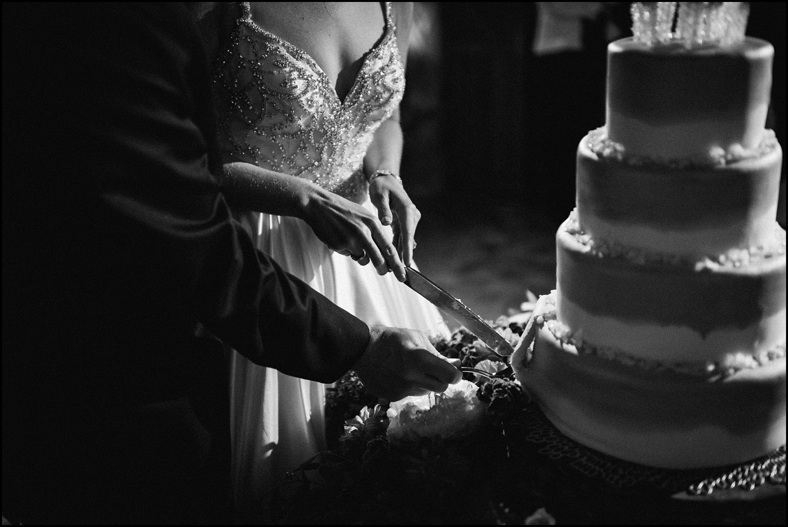 Cutting the cake at fall wedding