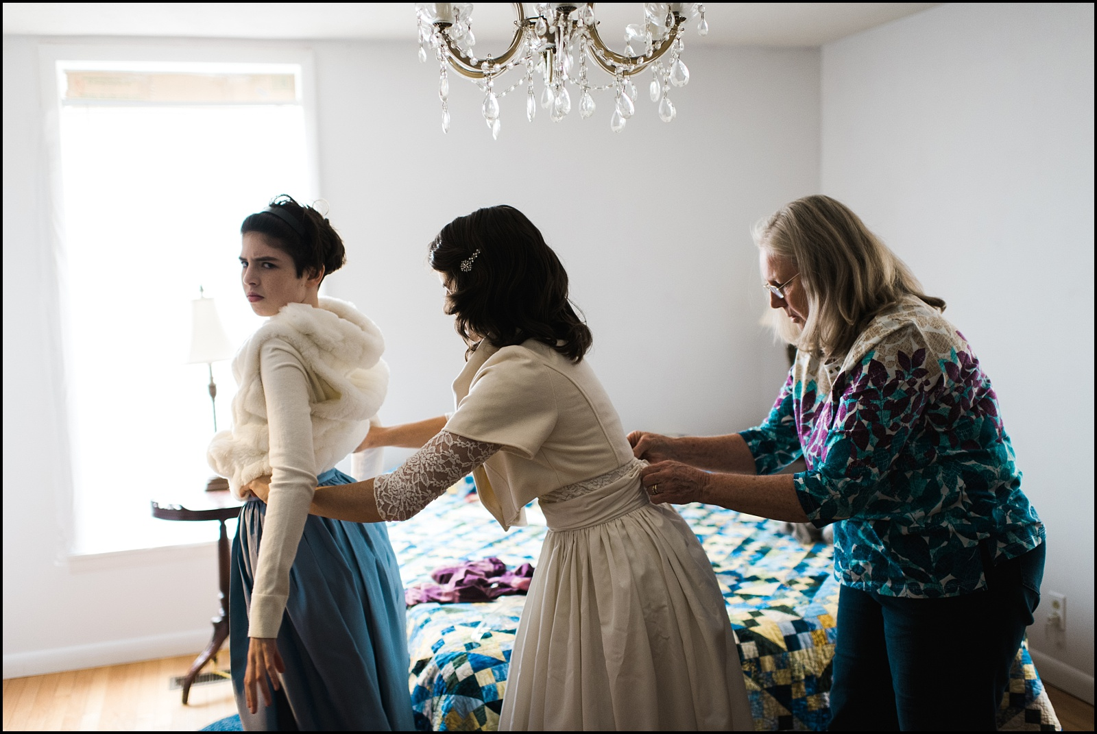 Mother, Bride and daughter getting ready for wedding