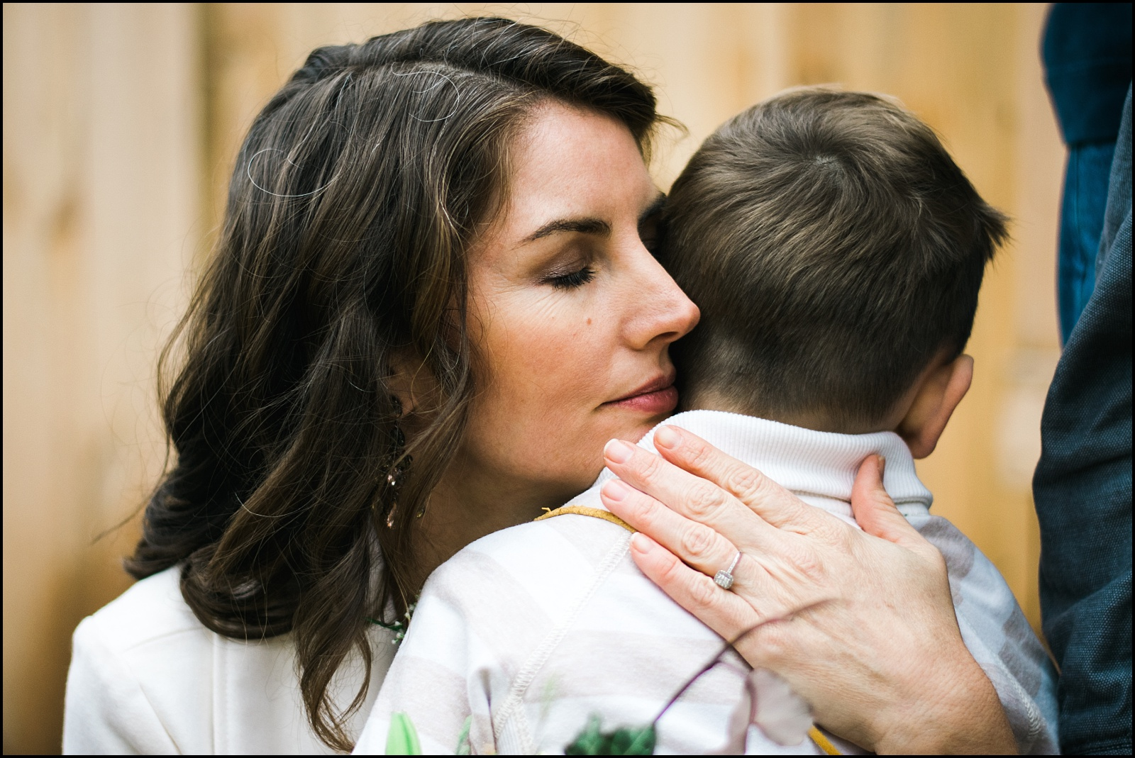 Candid photograph of bride with son