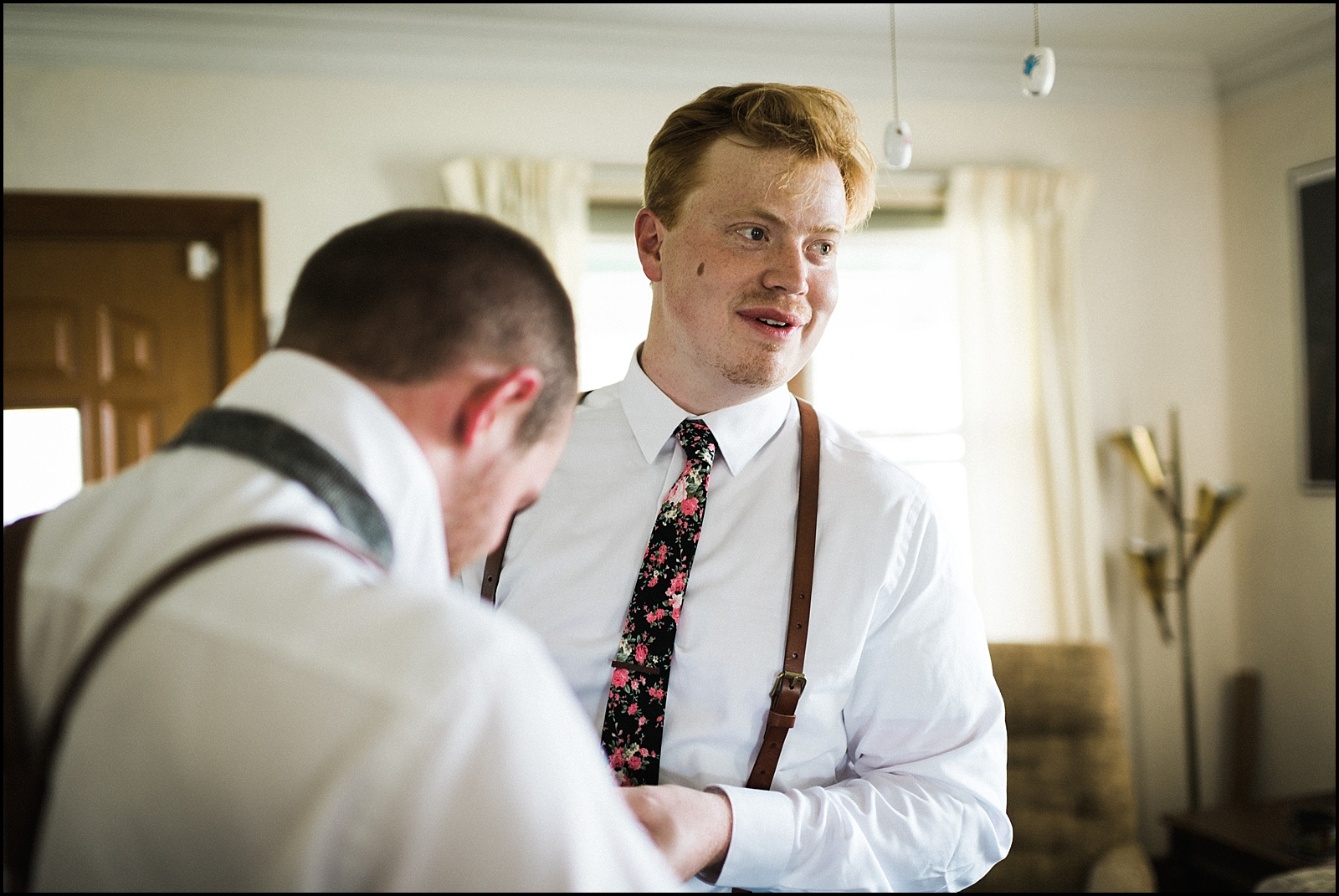 Groom with tie on
