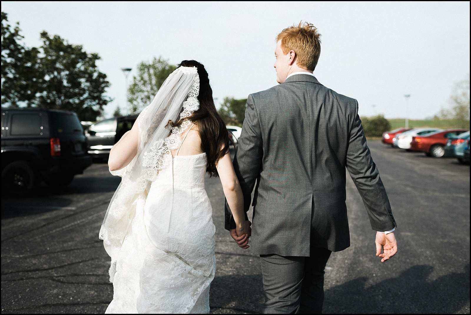 Bride and groom walking to car