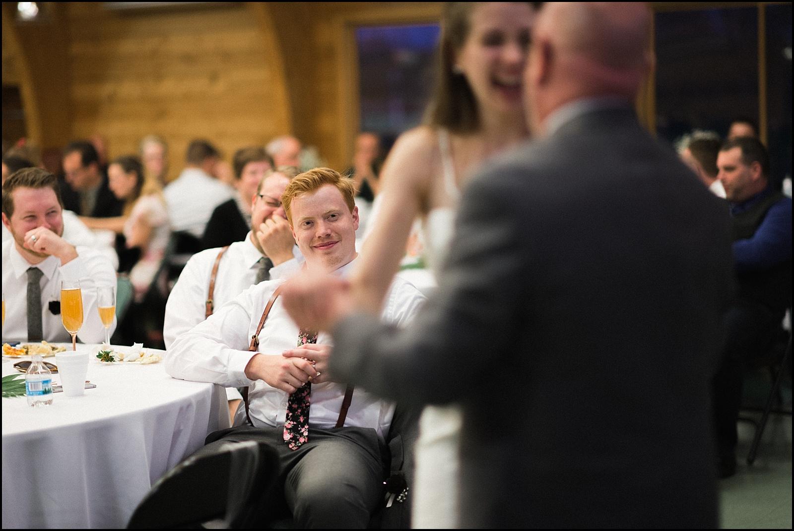 Candid groom watching dance