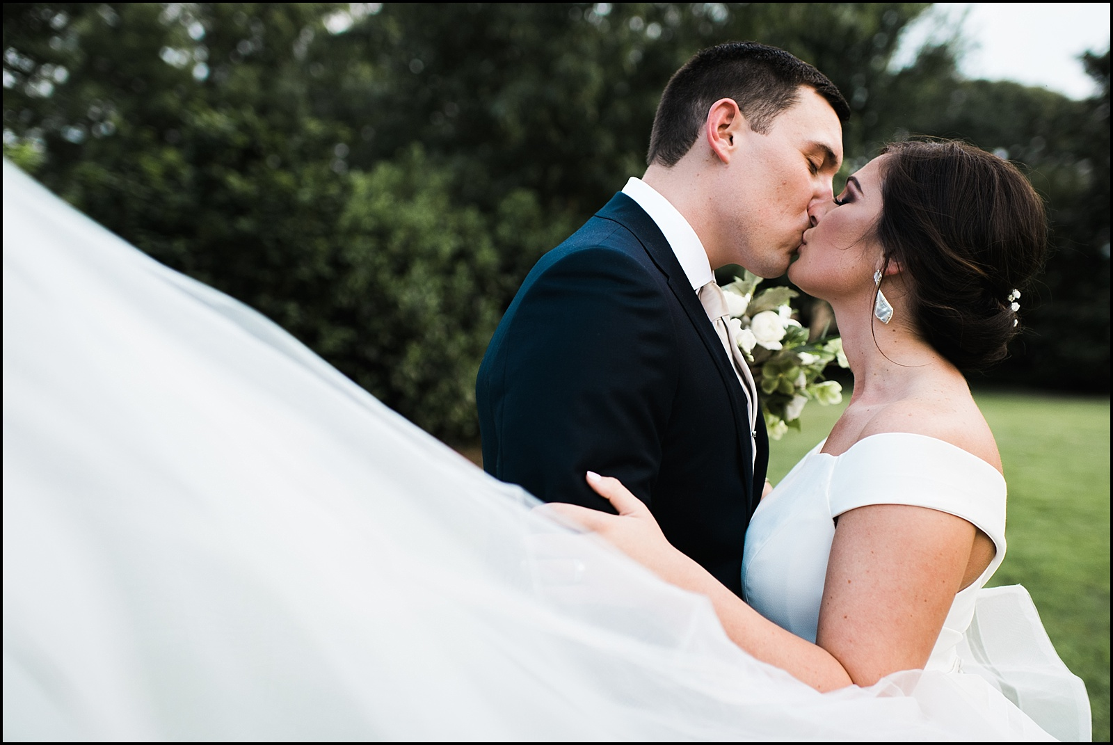 Kissing portrait at wedding