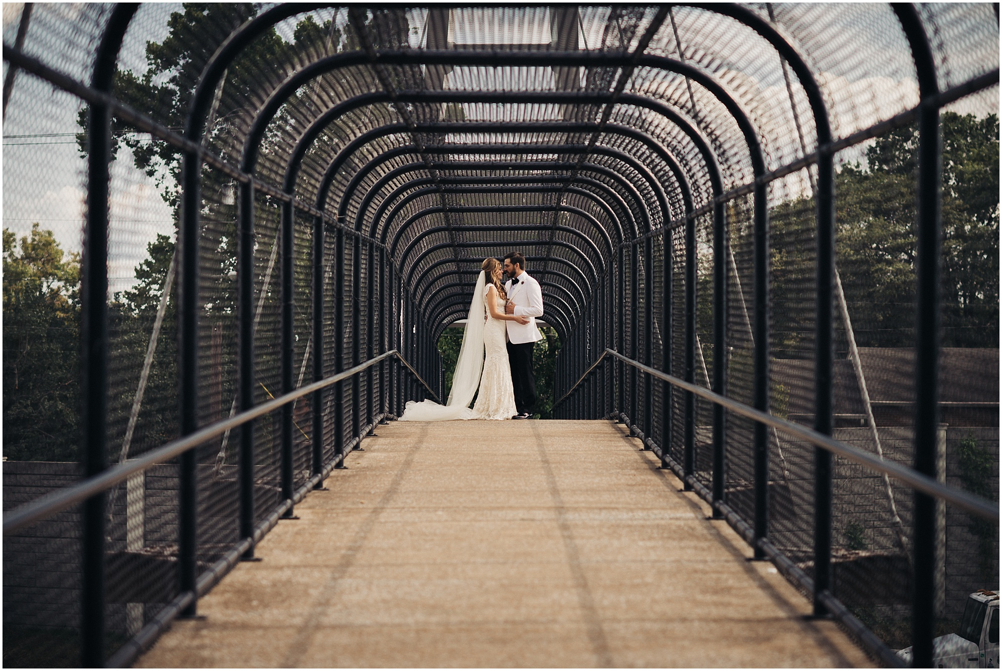 Urban bridge wedding portrait