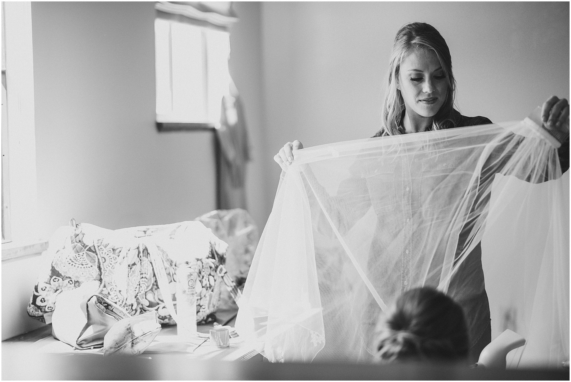 Bride cleaning veil