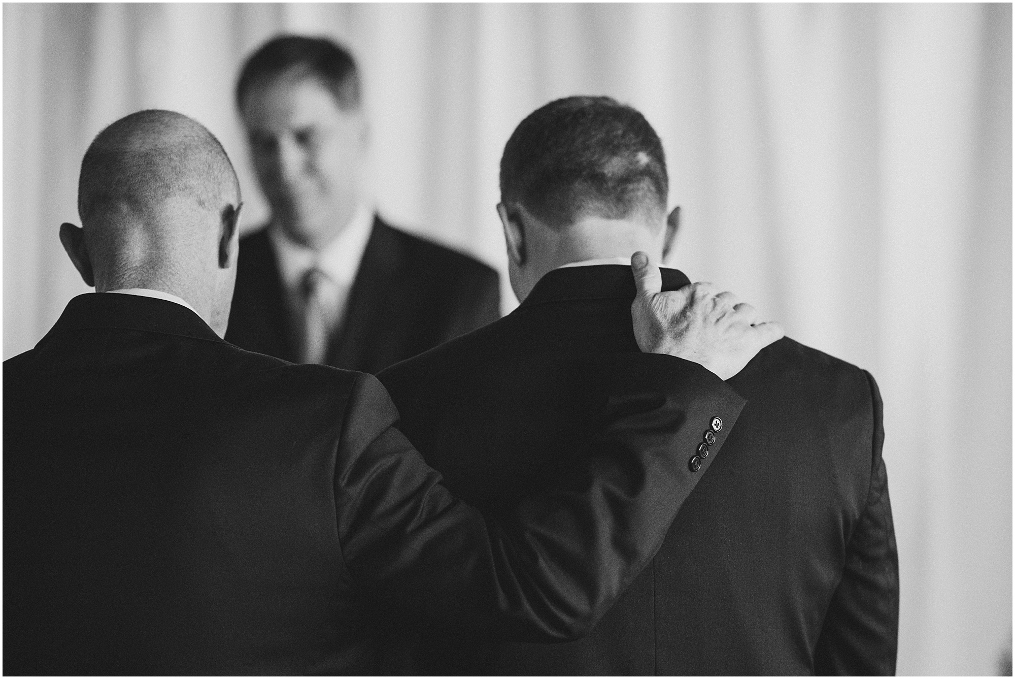 Father comforting groom