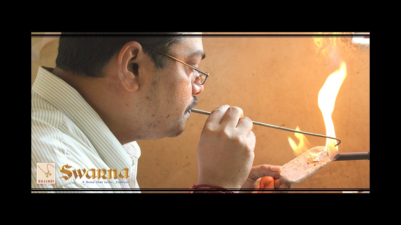 A Senior artisan Completeing an Intricate Solder