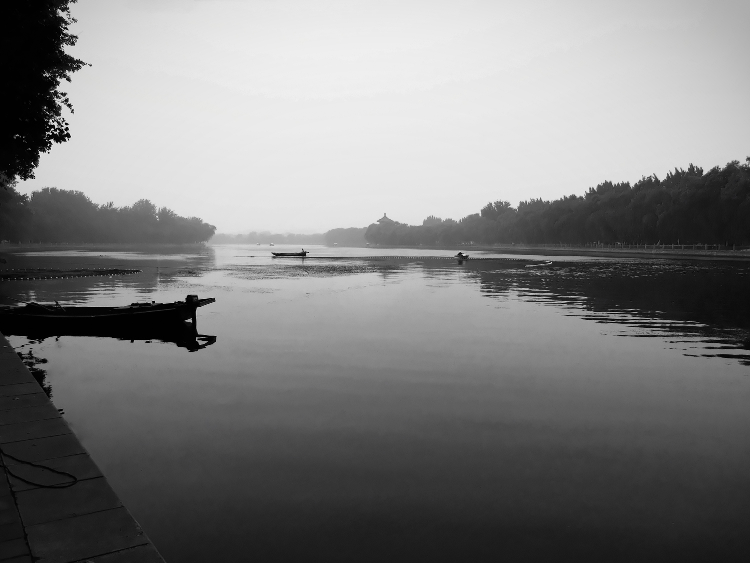 picture of houhai lake with boats in black and white in beijing china