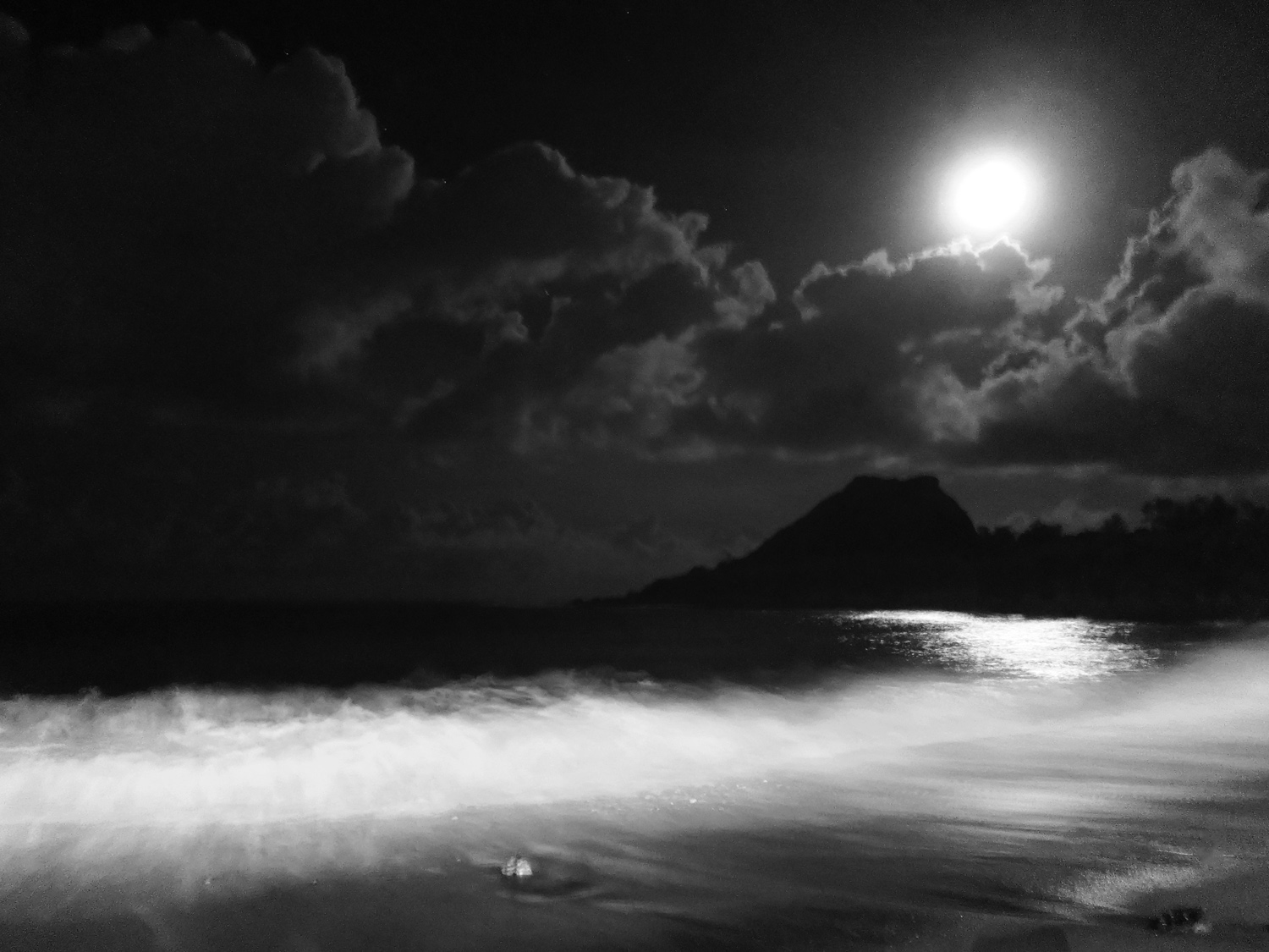 picture on the beach of kenting, baisha beach, in black and white during the night with the moon, taiwan