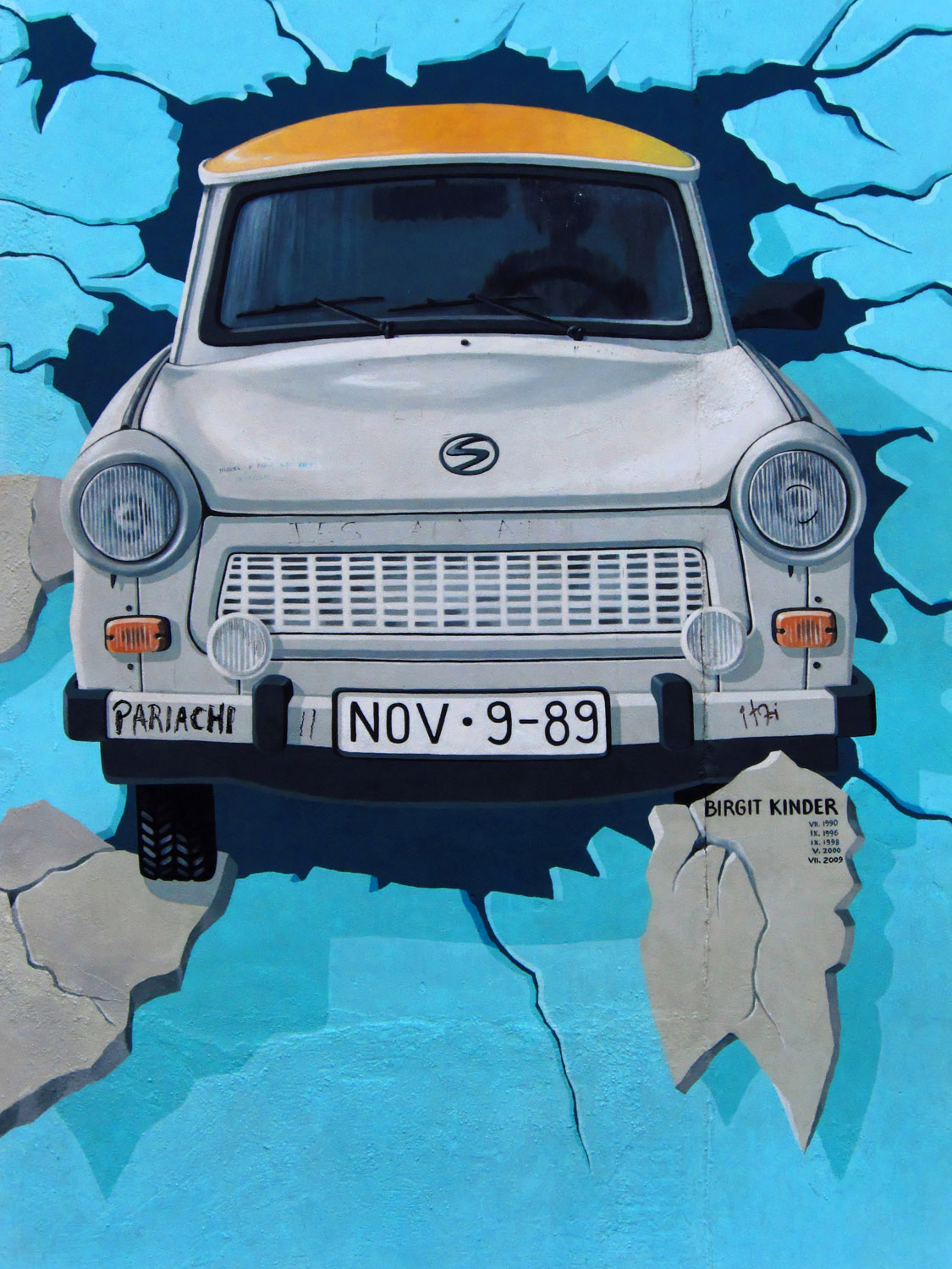 part of the berlin wall  street art with an old trabant german car drawned by birgit kinder
