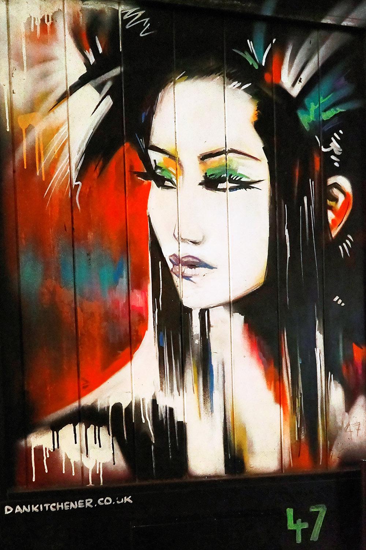 street art graffiti of a geisha by dan Kitchener brick lane east London england