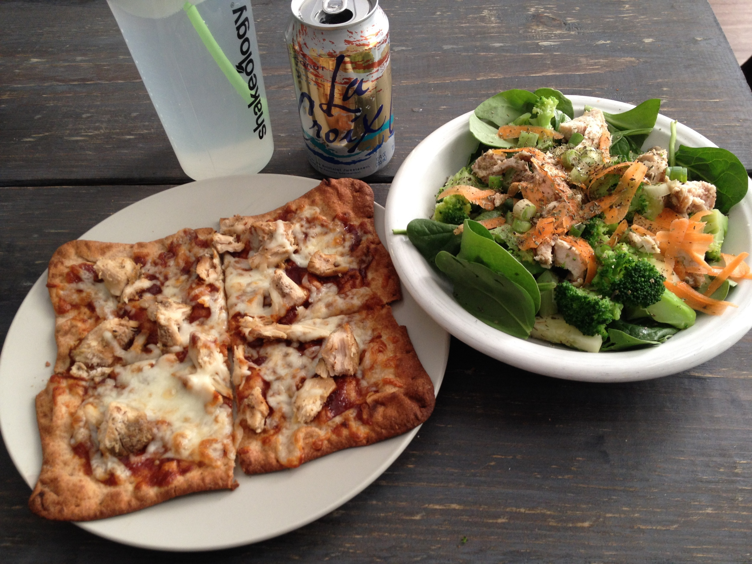 Pizza is one of the main food groups, right? Pizza, water in a Shakeology bottle, La Croix, and vegetable medley salad. Yum.