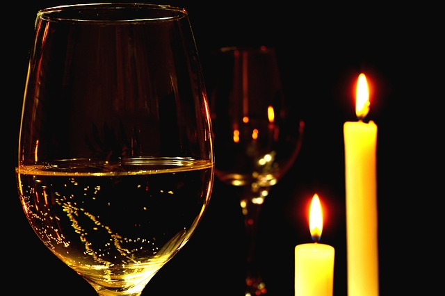 champagne by lit candles