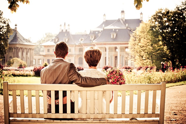 couple sitting by the bench