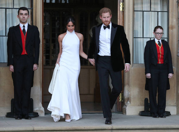 Meghan Markle changed into a stunning bespoke lily white high neck gown made of silk crepe designed by  Stella McCartney and  Aquazzura silk shoes.