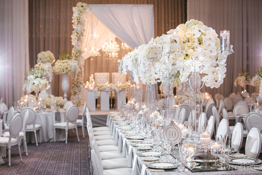 Stunning white and crystal table decor -  Wedluxe .