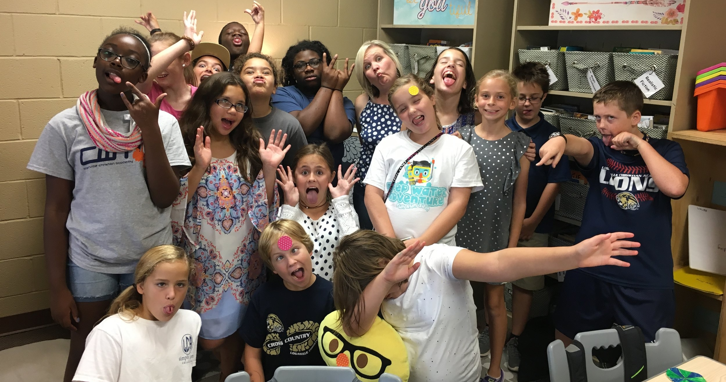 Mrs. Lambert's 5th grade class strikes a silly pose for International Dot Day!