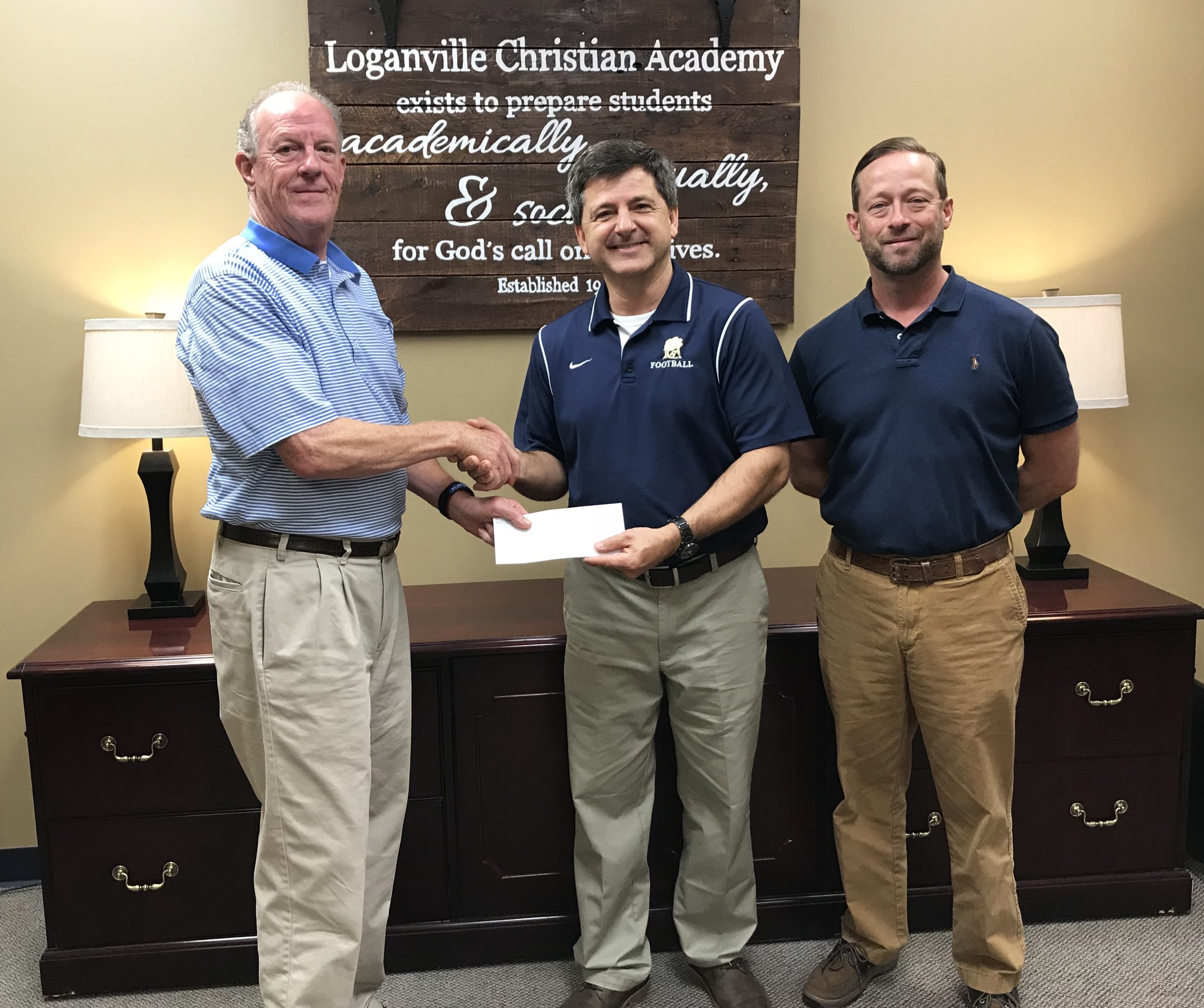 Members of the Walton County Health Care Foundation present LCA CFO Doug Monda with a check in the amount of $21,895.
