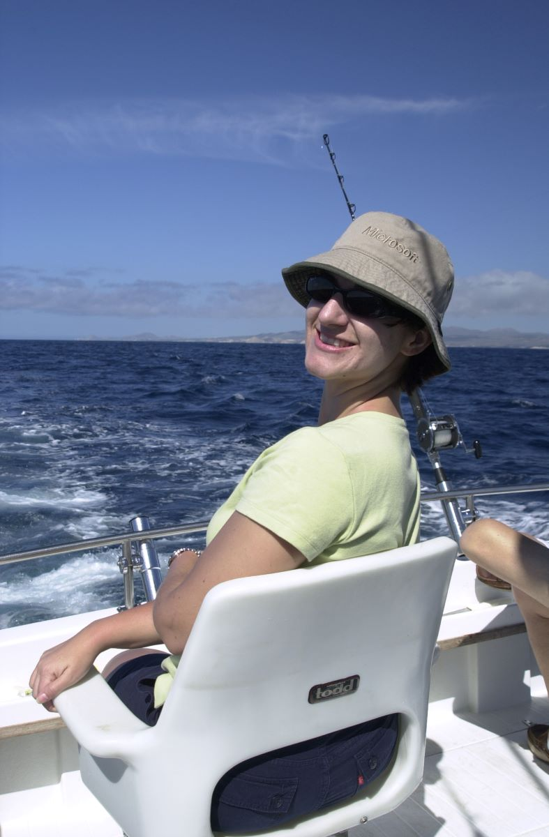 Danna, happy as can be fishing.
